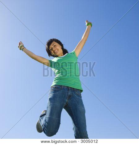 Happy Teen Jumps In Air