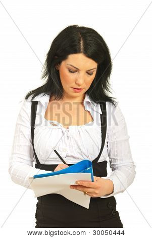 Executive Woman Writing On Papers