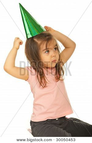 Girl Trying To Put Party Hat