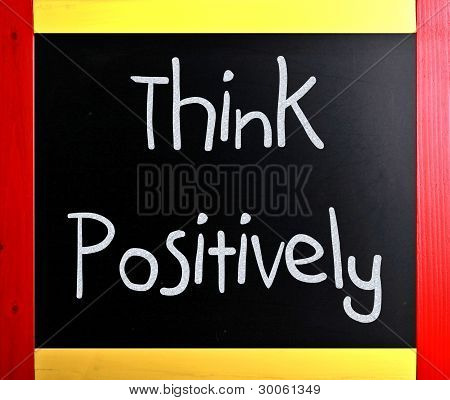 """think Positively"" Handwritten With White Chalk On A Blackboard"