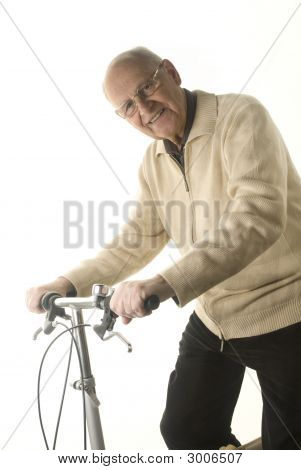 Active Senior Man On His Bicycle