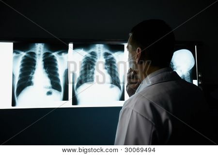 Doctor Working In Hospital During Examination Of X-rays