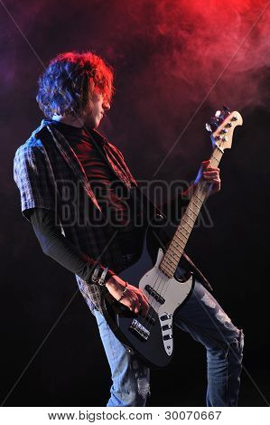 A Bassist Plays At A Live Concert