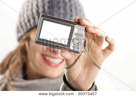 Woman With A Camera Taking A Photo Of Herself - Display Is White