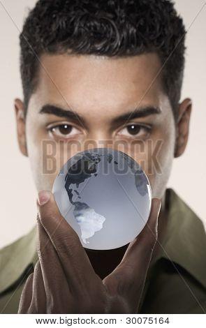 Portrait of man holding tiny globe