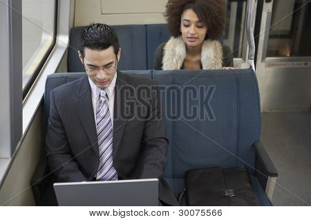Businessman commuting with laptop