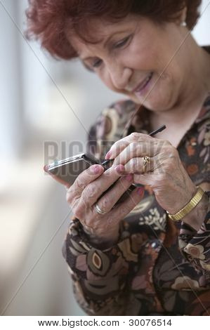Senior woman with electronic organizer