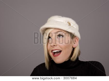 Blonde In Fur Hat Looking Up Surprised