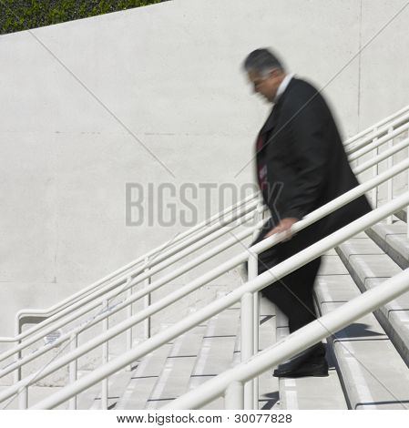 Businessman walking down steps