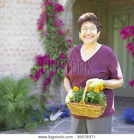 Portrait of woman with basket of flowers