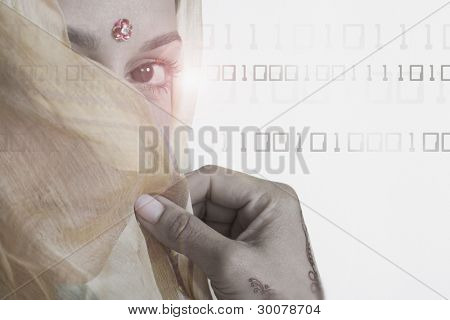 Woman in traditional Indian dress against binary background