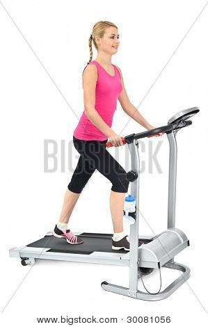 young woman doing exercises on treadmill, on white background