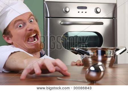 Funny Young Chef With A Pot