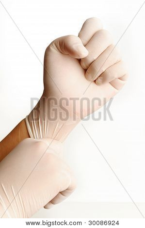 Rubber Medical Gloves On White