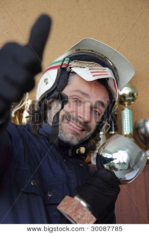 motorcyclist With Cups And Trophies
