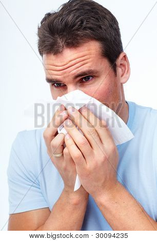 Sneezing man having cold. Isolated on white background.