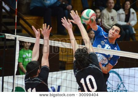 KAPOSVAR, HUNGARY - FEBRUARY 12: Gabor Nacsa (R) in action at a Hungarian volleyball National Championship game Kaposvar (blue) vs. Debrecen (black), on February 12, 2012 in Kaposvar, Hungary.