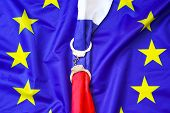 Flag Of Russia In Handcuffs On The Background Of The Flag Of The European Union. European Union Sanc poster