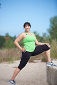Plus Size Female Exercise Stretch Outdoor Under Sunny Blue Sky