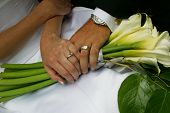 Newly Married Couple Holding Hands Wedding Bouquet