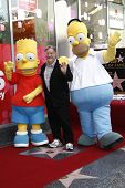 LOS ANGELES, CA - FEB 14: Bart Simpson; Matt Groening; Homer Simpson at a ceremony as Matt Groening