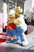 LOS ANGELES, CA - FEB 14: Bart Simpson; Homer Simpson at a ceremony as Matt Groening receives a star