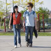 foto of skat  - Two kids walk home through a park - JPG