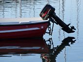 stock photo of outboard engine  - black outboard engine on the plastic boat - JPG