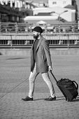 Adjust Living In New City. Man Bearded Hipster Travel With Luggage Bag On Wheels. Traveler With Suit poster