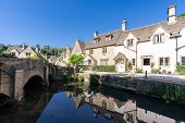 Castle Combe village in Cotswolds England UK poster