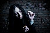 foto of opiate  - pretty girl with pill posing over wall - JPG