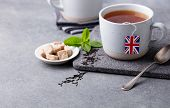 Tea In Mugs With British Flag Tea Bag Label. Grey Background. Copy Space poster