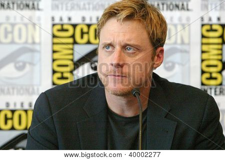 "SAN DIEGO, CA - JULY 13: Alan Tudyk attends a press conference for  ""Firefly"" at the 2012 Comic Con convention press room at the  Bayfront Hilton Hotel on Friday, July 13, 2012 in San Diego, CA."