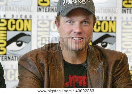 "SAN DIEGO, CA - JULY 13: Adam Baldwin attends a press conference  for ""Firefly"" at the 2012 Comic Con convention press room at the  Bayfront Hilton Hotel on Friday, July 13, 2012 in San Diego, CA."