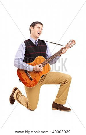 Full length portrait of a male playing a guitar and singing isolated against white background