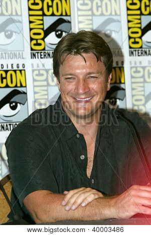 "SAN DIEGO, CA - JULY 13: Nathan Fillion attends a press conference  for ""Firefly"" at the 2012 Comic Con convention press room at the  Bayfront Hilton Hotel on Friday, July 13, 2012 in San Diego, CA."