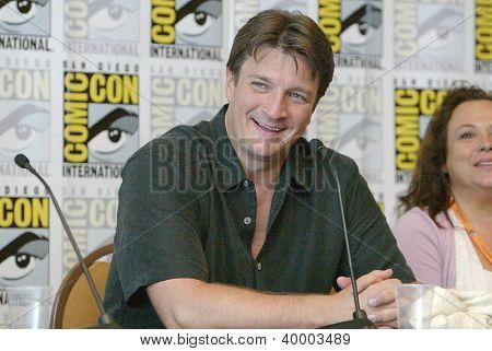 """SAN DIEGO, CA - JULY 13: Nathan Fillion attends a press conference  for """"Firefly"""" at the 2012 Comic Con convention press room at the  Bayfront Hilton Hotel on Friday, July 13, 2012 in San Diego, CA."""