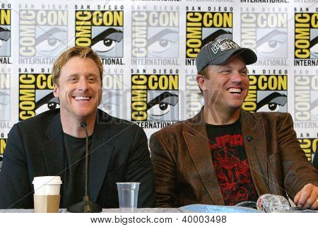 "SAN DIEGO, CA - JULY 13: Alan Tudyk & Adam Baldwin in the  press conference for ""Firefly"" at the 2012 Comic Con convention  press room at the Bayfront Hilton Hotel on July 13, 2012 in  San Diego, CA."