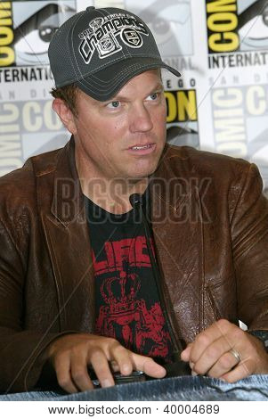 """SAN DIEGO, CA - JULY 13: Adam Baldwin attends a press conference  for """"Firefly"""" at the 2012 Comic Con convention press room at the  Bayfront Hilton Hotel on Friday, July 13, 2012 in San Diego, CA."""