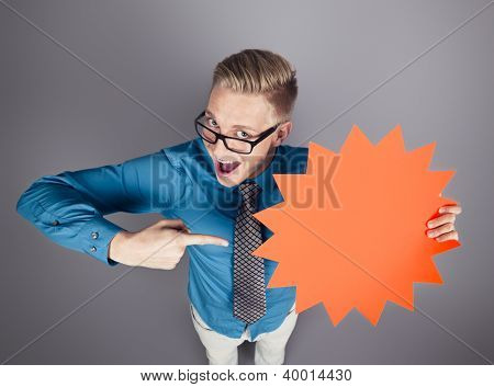 Fantastic offer: Joyful salesman pointing finger at blank panel with space for text promoting sales isolated on grey background.