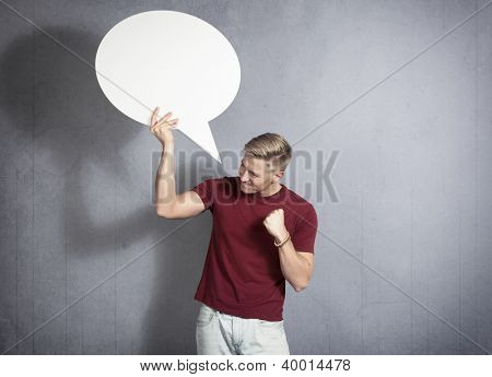 Bad news: Disappointed man holding white empty speech balloon with space for text isolated on white background.