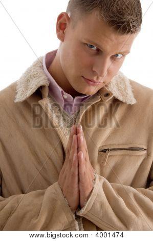 Praying Male Looking At Camera