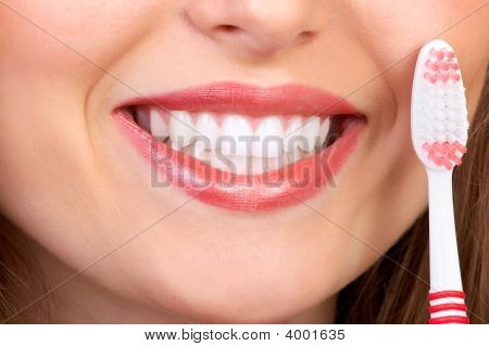 Woman With Tooth-Brush