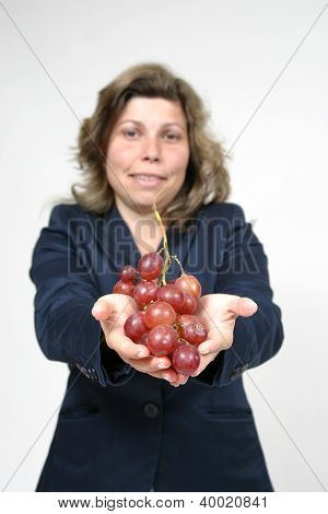 beautiful woman with red grapes, healthy food
