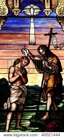 Stained glass window of baptism of Jesus
