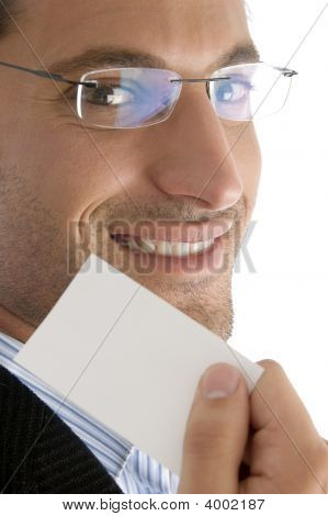 Close Up Of Young Good Looking Man With Business Card