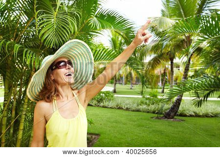 Woman in the tropical garden. Vacation.