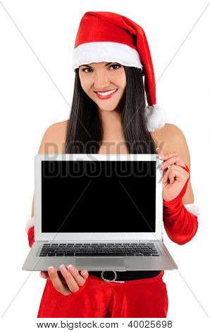 Isolated young christmas girl showing laptop
