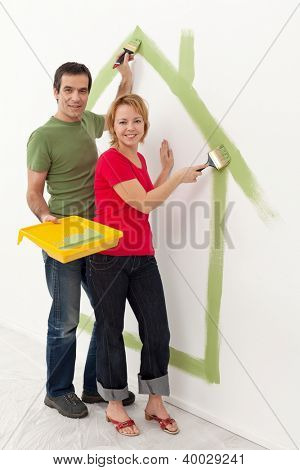 Couple dreaming up their new home - painting it on the wall