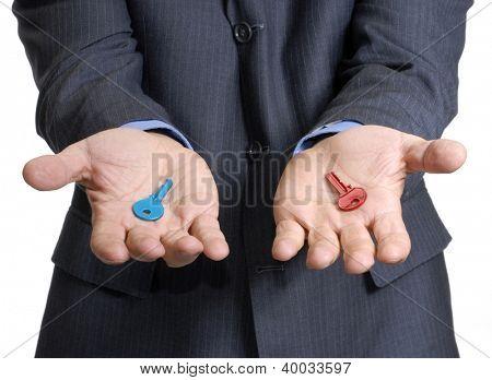 Businessman hands holding two keys.